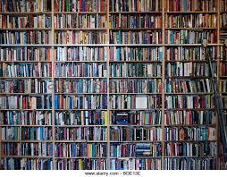 Many books on shelves inside secondhand bookshop in Prenzlauer Berg Berlin  Germany - Stock Image