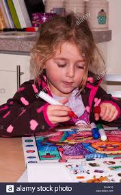 5 year old colouring a picture in a colouring book
