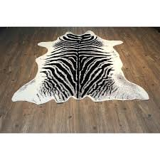 white faux cowhide rug and silver