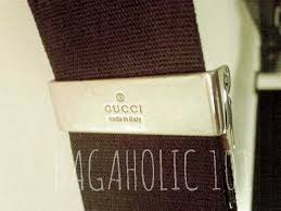 gucci bags made in italy. gucci made in italy engraved on the strap hardware of a gucci crossbody bag - tips bags