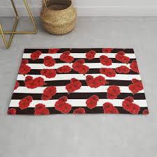 red poppies on a black and white striped background rug