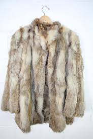 image 1 of 2 light brown and cream color fur coat