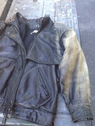 faded black leather jacket before