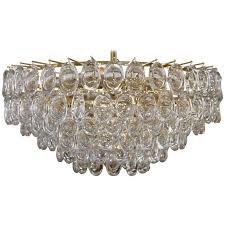 tiered oval crystal lens element brass chandelier