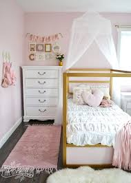 a shabby chic glam girls bedroom design idea in blush pink white and gold with tons of kids organization ideas room girl rug