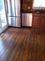 High Quality Stunning Dark Brown Finish Hardwood Floor Vs Laminate Installed In The  Awesome Kitchen Decor Great Ideas
