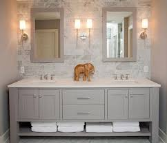 double vanity with two mirrors. refined llc: exquisite bathroom with freestanding gray double sink vanity topped white counter. two mirrors