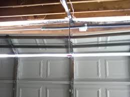 repair bent garage door strut fluidelectric