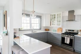 a gray and white kitchen makeover using ikea cabinetry marble like quartz countertops subway