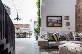 living room sofa table concrete floor rug floor chair pendant