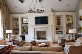 built in cabinets for family room living room traditional with window treatment wood window treatment