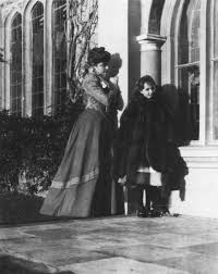 A young Vita Sackville-West (being consumed by a large fur coat) with her  mother, Lady Victoria Sackville-West, 1899. | Victoria, Virginia wolf, Lady