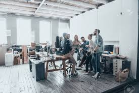 the creative office. Delighful Creative Full Length Of Young Creative People In Smart Casual Wear Having A  Brainstorm Meeting While Standing Behind The Glass Wall Office On The Creative Office S