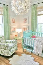 gender neutral nursery with green accents