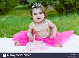 Smiling Happy Baby Toddler Girl In First Birthday Party With Pink