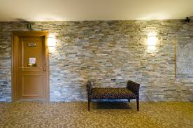 creative faux stone panels for wall interior decor combined with brown carpet tiles with flower pattern ideas