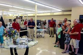 Fabric business and quilting machine distributor becomes part of ... & ... Open house for the new location of Accomplish Quilting Adamdwight.com