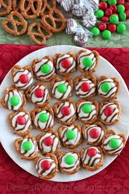 these festive pretzel hugs are melted just enough to press an m m on the top