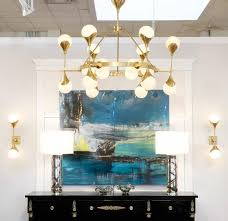 a breathtaking and brilliant murano globe glass and textured brass chandelier this illuminating piece holds