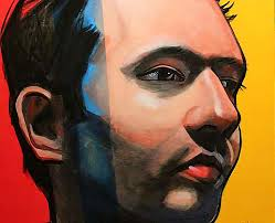 close up of bright acrylic portrait painting of a young man
