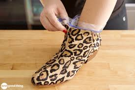 an undersized cheetah print boot with a ziploc bag being pushed into it