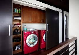 modern waypoint laundry room in 630f cherry chocolate featuring barn door closet doors