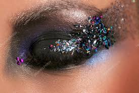 models eye with makeup and colorful crystals close up stock photo