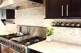 tile backsplash white cabinets black countertops open design kitchen flush with natural wood lighter shade hardwood