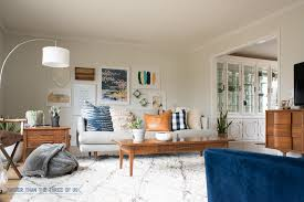 Modern bright living room Half And Half Gallery Wall In Midcentury Bright And Modern Living Room Bigger Than The Three Of Us Everchanging Modern And Bright Living Room Bigger Than The Three