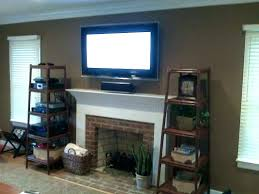 tv above fireplace too high above fireplace too high mounting a over fireplace above brick hiding