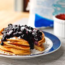 blueberry sauce with fresh blueberries sugar vanilla and corn starch on a blue
