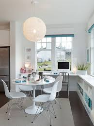 Contemporary eat-in kitchen idea in Vancouver with shaker cabinets, white  cabinets and stainless