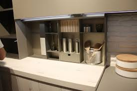 feminine white kitchen design with led under cabinet lighting