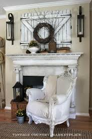 I love the wall decor above the mantel must remember the rustic barn  doors hiding