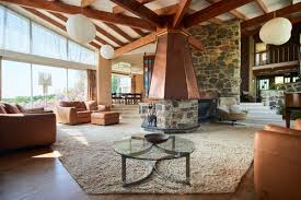 the stunning living area with a copper clad fireplace all photos via the modern house