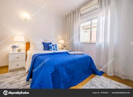Turn On The Bedroom Light An Elegant Bedroom Arranged In White And Blue With Turn On