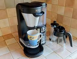 Turn it on, fill the water reservoir, add ground coffee to the filter, place the carafe under the brew basket, and press. Our Review Of The Ninja Coffee Bar Brewer