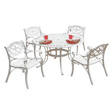 white 5 piece round patio dining set with green