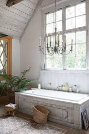 Classic chandelier, unique bathtub and farmhouse charm shape a relaxing  bathroom [From: Illuminations