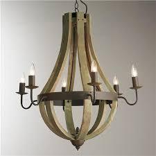 wine barrel chandelier installed by dallas landscape lighting moss green