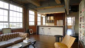 View in gallery Industrial loft living room with a tufted sofa