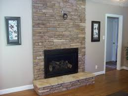 stone fireplace with tv new fireplace we put stone over the brick and got