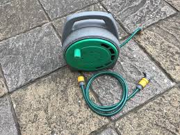 hozelock garden hose on a reel with tap ings
