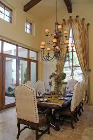 formal window treatments dining room terranean with beige tile floor chandelier