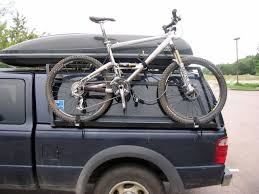 truck bed pvc bike rack on the side of the camper. Nice use of space ...