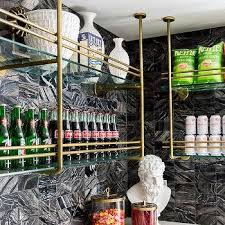 black marble tiles with brass and glass snack shelves