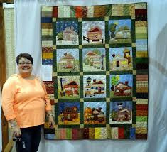 Squash House Quilts: Quilt Show in the Big City & It's an adorable house quilt which combines patchwork, needle turn  applique, hand embroidery and lots of love! The theme of the show was