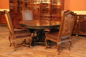 60 inch round walnut table with hide back french style chairs