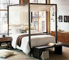 ... Black modern canopy bed with walnut nightstand, drawer chest and bench