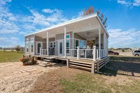 oversized tiny house with wraparound porch